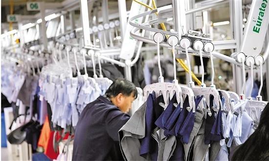 十九大报告中提到的新要求 萧山这家服装企业干成了0.jpg